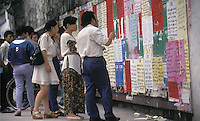 A group of jobseekers look at job advertisements on a wall in Guangzhou, China..24 Aug 1998