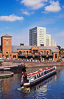 England. Birmingham.  Urban renewal.  Canal basin and canal side warehouses converted to recreational use have brought life back to the centre of a city in Britain's decaying manufacturing heartland.  Imaginative use has been made of an otherwise redundant infrastructure.