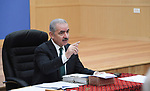 Palestinian Prime Minister Mohammed Ishtayeh chairs the weekly meeting of his government, in the West Bank city of Ramallah on September 6, 2021. Photo by Prime Minister Office
