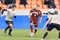 Houston, TX - Friday December 9, 2016: Blake Elder (6) of the Denver Pioneers brings the ball up the field against the Wake Forest Demon Deacons at the NCAA Men's Soccer Semifinals at BBVA Compass Stadium in Houston Texas.