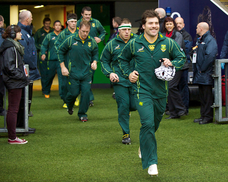 Schalk Brits of South Africa enjoys the moment as he runs onto the pitch before the QBE Autumn International match between England and South Africa at Twickenham on Saturday 24 November 2012 (Photo by Rob Munro)
