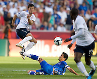 Benny Feilhaber of the USA jumps over a sliding Ramon Sanchez of El Salvador during a World Cup Qualifying match at Rio Tinto Stadium, in Sandy, Utah, Friday, September 5, 2009. The USA won 2-1.