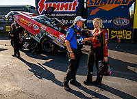 Sep 17, 2017; Concord, NC, USA; NHRA funny car driver Courtney Force (right) talks with father John Force after losing in the final round of the Carolina Nationals at zMax Dragway. Mandatory Credit: Mark J. Rebilas-USA TODAY Sports