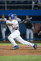 Nick Horvath (26) of the Florida Gators follows through on his swing against the Wake Forest Demon Deacons in Game One of the Gainesville Super Regional of the 2017 College World Series at Alfred McKethan Stadium at Perry Field on June 10, 2017 in Gainesville, Florida.  The Gators defeated the Demon Deacons 2-1 in 11 innings.  (Brian Westerholt/Four Seam Images)