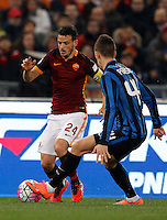 Calcio, Serie A: Roma vs Inter. Roma, stadio Olimpico, 19 marzo 2016.<br /> Roma's Alessandro Florenzi, left, is challenged by FC Inter's Ivan Perisic during the Italian Serie A football match between Roma and FC Inter at Rome's Olympic stadium, 19 March 2016. The game ended 1-1.<br /> UPDATE IMAGES PRESS/Riccardo De Luca