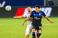CARSON, CA - OCTOBER 14: Andres Rios #25 of the San Jose Earthquakes and Perry Kitchen #2 of the Los Angeles Galaxy chase down a loose ball during a game between San Jose Earthquakes and Los Angeles Galaxy at Dignity Heath Sports Park on October 14, 2020 in Carson, California.