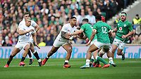 Manu Tuilagi of England runs into Jonathan Sexton (c) of Ireland during the Guinness Six Nations match between England and Ireland at Twickenham Stadium on Sunday 23rd February 2020 (Photo by Rob Munro/Stewart Communications)