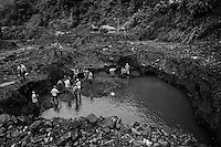 """Emerald miners in Muzo, Boyaca department, Colombia. Digging in the mud in the outskirts of an emeral mine in Muzo, hundreds of people face a life of sacrifice and privations looking for those """"two minutes of good luck"""" that will save them forever. Many of them dye in the attempt , few of them got any luck at all."""