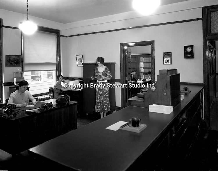 Pittsburgh PA:  Employees at work in the Office of the Registrar, Duquesne University.<br /> Brady Stewart was hired to photography the campus, classrooms, and offices for a publication to increase enrollment at the Catholic University.