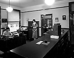 Pittsburgh PA:  Employees at work in the Office of the Registrar, Duquesne University.<br />