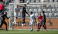 LOS ANGELES, CA - APRIL 17: Tristan Blackmon #27 of LAFC heads a ball during a game between Austin FC and Los Angeles FC at Banc of California Stadium on April 17, 2021 in Los Angeles, California.