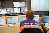 Workers in the despatch room of Helsinki Energy, the municipally-owned company which supplies 90% of the Finnish capital's electricity.
