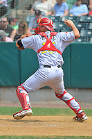 Catcher Logan Moore (15) of the Reading Fight Phils throws to second base during a game against the New Britain Rock Cats at New Britain Stadium on July 13, 2014 in New Britain, Connecticut.  Reading defeated New Britain 6-4.  (Gregory Vasil/Four Seam Images)