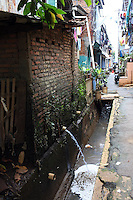Waste water empties into a drainage channel in a slum community in central Jakarta.<br /> <br /> To license this image, please contact the National Geographic Creative Collection:<br /> <br /> Image ID: 1588035 <br />  <br /> Email: natgeocreative@ngs.org<br /> <br /> Telephone: 202 857 7537 / Toll Free 800 434 2244<br /> <br /> National Geographic Creative<br /> 1145 17th St NW, Washington DC 20036