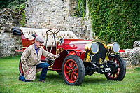 BNPS.co.uk (01202 558833)<br /> Pic: MaxWillcock/BNPS<br /> <br /> Pictured: National Motor Museum's Ben Wanklyn cleans Mr Toad's car in the museum grounds.<br /> <br /> Mr Toad's car from Wind in the Willows has gone on display after a painstaking restoration following years of neglect.<br /> <br /> The vehicle was made for the 1996 film adaptation of Kenneth Grahame's classic 1908 children's book starring Terry Jones as the obsessive amphibian.<br /> <br /> The car, which appears to be from the Edwardian era, was actually built in 1995 at Shepperton Studios for the film.<br /> <br /> Following the film's release, it was transported to America, where it spent many years hanging from the ceiling of a Florida restaurant.<br /> <br /> It was brought back to Britain last year in a dilapidated state and has been restored at the National Motor Museum workshop in Beaulieu, Hants, where visitors can see it driven around the grounds.