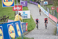 Mathieu Van der Poel (NED/Alpecin-Fenix) & Kasper Asgreen (DEN/Deceuninck - Quick Step) in the last ascent up the Paterberg at the moment Wout van Aert (BEL/Jumbo-Visma) realised he wouldn't win this edition of De Ronde<br /> <br /> 105th Ronde van Vlaanderen 2021 (MEN1.UWT)<br /> <br /> 1 day race from Antwerp to Oudenaarde (BEL/264km) <br /> <br /> ©kramon