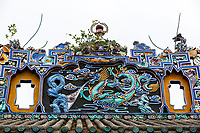 George Town, Penang, Malaysia.  Dragon Roof Decoration above the Chung Ancestral Temple, Peranakan Mansion.