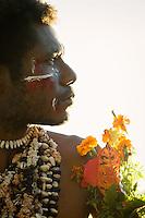 Man in traditional dress at sunrise, Mclaren Harbour, Tufi, Cape Nelson, Oro Province, Papua New Guinea