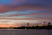 Vibrant sunset over Austin Skyline and Lady Bird Lake from East Riverside Drive in East Austin, Texas.