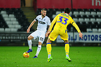 Brandon Cooper of Swansea City U21 vies for possession with Alex Rodman of Bristol Rovers during the Checkatrade Trophy match between Swansea City U21 and Bristol Rovers at the Liberty Stadium in Swansea, Wales, UK. Wednesday 05 December 2018