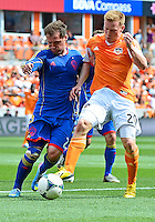 April 28, 2013: Colorado Rapids mid fielder Jamie Smith #20 and Houston Dynamo mid fielder Andrew Driver #20 vying for ball possession during Major League Soccer match in Houston  TX. Houston Dynamo draw 1-1 against Colorado Rapids.