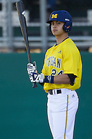 Michigan Wolverines second baseman Hector Gutierrez (24) at bat during the NCAA season opening baseball game against the Texas State Bobcats on February 14, 2014 at Bobcat Ballpark in San Marcos, Texas. Texas State defeated Michigan 8-7 in 10 innings. (Andrew Woolley/Four Seam Images)