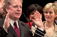 April 14, 2003, Montreal, Quebec, Canada<br /> <br /> Jean Charest, Leader of  Quebec Liberal Party <br /> and Quebec new Premier and<br /> MichÀle Dionne ,  his wife (R) adresses the Liberal  troops in Montreal on the  provincial election night,<br /> <br /> the election results are<br />  45,4 % of the vote for his Jean Charest's Liberal party,<br /> 33,4 % of the vote for Bernard Landry's Parti Quebecois and<br /> 18,6 % of the votes for Mario Dumont's Action Democratique du Quebec<br /> <br /> <br /> Mandatory Credit: Photo by Pierre Roussel- Images Distribution. (©) Copyright 2003 by Pierre Roussel