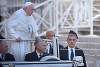 Pope Francis, flanked by newly appointed Vatican head of security Gianluca Gauzzi Broccoletti, arrives for his weekly general audience, in St.Peter's Square, at the Vatican, Wednesday, Oct. 16, 2019.