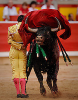 Spanish matador Ivan Fandino gives a pass to a El Pilar bull during the fourth corrida of the San Fermin Festival, on July 10, 2012, in the Northern Spanish city of Pamplona . (c) Pedro ARMESTRE