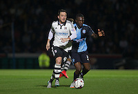 Ross McCormack of Fulham and Anthony Stewart of Wycombe Wanderers in action during the Capital One Cup match between Wycombe Wanderers and Fulham at Adams Park, High Wycombe, England on 11 August 2015. Photo by Andy Rowland.