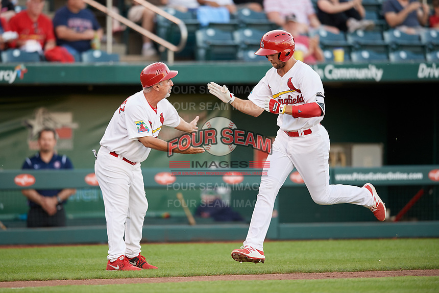 Springfield Cardinals second baseman Dickie Joe Thon (35) is congratulated by manager Johnny Rodriguez (18) after hitting a home run in the bottom of the fifth inning during a game against the Corpus Christi Hooks on May 30, 2017 at Hammons Field in Springfield, Missouri.  Springfield defeated Corpus Christi 4-3.  (Mike Janes/Four Seam Images)