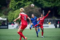Seattle, WA - Saturday May 13, 2017: Rebekah Stott and Francisca Ordega during a regular season National Women's Soccer League (NWSL) match between the Seattle Reign FC and the Washington Spirit at Memorial Stadium.