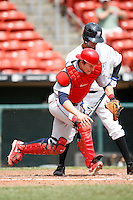 May 28, 2009:  Lehigh Valley IronPigs Catcher Lou Marson fields a bunt by Nelson Figueroa during a game vs. the Buffalo Bisons at Coca-Cola Field in Buffalo, NY.  The IronPigs are the International League Triple-A affiliate of the Philadelphia Phillies.  Photo by:  Mike Janes/Four Seam Images