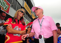 May 1, 2011; Baytown, TX, USA: NHRA former top fuel dragster driver Shirley Muldowney (right) talks with pro stock motorcycle rider Angie Smith during the Spring Nationals at Royal Purple Raceway. Mandatory Credit: Mark J. Rebilas-