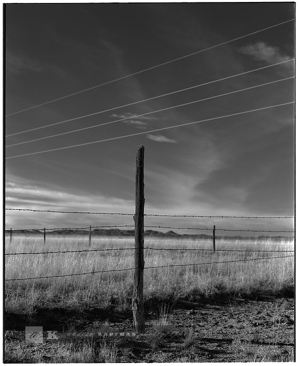 1997 --  New Mexico. -- Barb wire fence in southern New Mexico. Scenes from the great state of New Mexico. Along Route 66 and down towards White Sands National Monument..©Andrew Kaufman