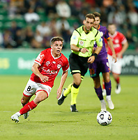 18th April 2021; HBF Park, Perth, Western Australia, Australia; A League Football, Perth Glory versus Wellington Phoenix; Cameron Devlin of Wellington Phoenix makes a break as the referee waves play on