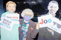 """A delegate brought cardboard cutouts of Barack Obama and Hillary Clinton as people gathered to watch the 2020 Democratic National Convention at a """"Ridin' with Biden"""" Drive-In Theater viewing event at Suffolk Downs in Boston, Massachusetts, on Wed., Aug. 19, 2020."""