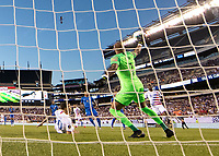 PHILADELPHIA, PA - JUNE 30: Christian Pulisic #10 shoots on goalie Eloy Room #1 who makes the save during a game between Curaçao and USMNT at Lincoln Financial Field on June 30, 2019 in Philadelphia, Pennsylvania.