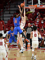 Arkansas forward Connor Vanover (center) blocks a shot Tuesday, Feb. 16, 2021, by Florida forward Osayi Osifo (15) during the first half of play in Bud Walton Arena. Visit nwaonline.com/210217Daily/ for today's photo gallery. <br /> (NWA Democrat-Gazette/Andy Shupe)