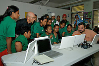 IN THE PUBLIC HIGH SCHOOL CHUUK, MICRONESIA, PACIFIC STUDENTS USING DONATED iBOOKS,IN THE PUBLIC HIGH SCHOOL CHUUK, MICRONESIA, a program at this school by Clark Graham and Andy Kerr for helping the not so unfortuned children in the pacific, the Mac iBooks have been donated, more software has been recently supplied by Apple, teaching the children arts and communication on a volunteer basis.. Clark teaches a group of high school students, some photography, art, communication and English. Clark who is a very dedicated volunteer (see his Bio below) managed to organize these iBooks for the Chuuk Public High School, an amazing task and a great opportunity for these Children in this remote part of the world..If you see the images you might understand a bit more about this public school, it is guys like Clark who dedicate their life to projects like these with the occasional help from Andy Kerr from Guam who was there this week on a visit to help out..The local Government and education Dept. don?t seam to care that much, the facts are;.A public high school with 600 children and not enough teachers, only two toilets, most of the time no power and drinking water, hence the children?s Podcast project reflecting the need for water and better facilities.