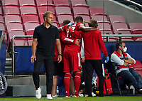 23rd August 2020, Estádio da Luz, Lison, Portugal; UEFA Champions League final, Paris St Germain versus Bayern Munich; Trainer Hansi Flick (M) commiserates with injured Jerome Boateng (M)