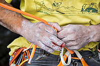 Lucho Birkner untying the rope from his harness, Los Huasamacos del Sur - cave sector; Valle des los Condores, Chile