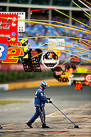 A member of the pit crew for Kurt Busch's Miller Lite No. 2 Dodge, driven for Penske Racing, sweeps up after a pit stop during the 2009 Coca-Cola Classic 600 race at the Lowe's Motor Speedway, in Concord, NC. NASCAR Driver David Reutimann ultimately won the race, and his first Sprint Cup, during the rain-shortened event, held May 25, 2009. NASCAR's longest scheduled race went only 227 laps, or 340.5 miles, before officials ended it because of rain. The 2009 race was the 50th running of the Coca-Cola 600. Ryan Newman and Robby Gordon finished second and third respectively.