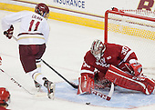 Chris Calnan (BC - 11), Landon Peterson (Wisconsin - 30) - The Boston College Eagles defeated the visiting University of Wisconsin Badgers 9-2 on Friday, October 18, 2013, at Kelley Rink in Conte Forum in Chestnut Hill, Massachusetts.