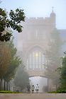 October 13, 2021; Students walk to class on a foggy morning, fall 2021. (Photo by Matt Cashore/University of Notre Dame)