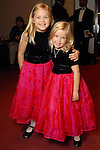 Isabelle Martel, 8, and Caroline Martel,6, at the opening night of The Nutcracker at the Wortham Theater Friday Nov. 27,2009. (Dave Rossman/For the Chronicle)