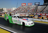 Feb. 14, 2013; Pomona, CA, USA; NHRA funny car driver Jack Beckman (near lane) races alongside teammate Ron Capps during qualifying for the Winternationals at Auto Club Raceway at Pomona.. Mandatory Credit: Mark J. Rebilas-