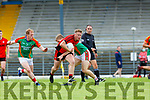 Kevin O'Sullivan Kenmare drives past Peter Crowley and Pa Kilkenny Mid Kerry during their SFC quarter final in Fitzgerald Stadium on Sunday