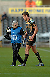 Injured Lee Byrne is helped by DALONI LUCAS, the Ospreys PHYSIOTHERAPIST as he leaves the field with a foot injury..Heineken Cup - Ospreys v Leicester Tigers at the Liberty Stadium in Swansea. ..