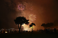 Crowds watch an earlier Fourth of July fireworks display from San Diego's Mission Bay Park on July 3rd 2008.  The fireworks display lasted 30 minutes and drew cheers and applause from the hundreds of San Diegans crowded into the park next to the Paradise Point Resort & Spa.
